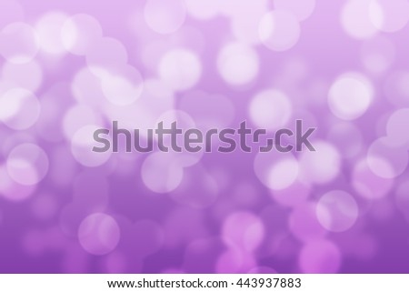 Abstract circular violet and purple light bokeh background