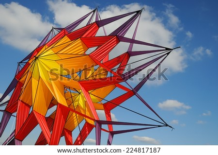 Abstract, color full kite in a blue sky