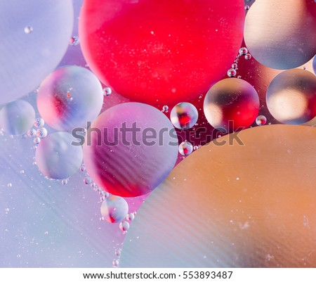 Abstract colorful backdrop with oil drops and waves on water surface