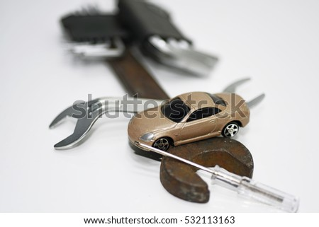 Abstract composition of broken car and repair process.