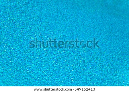Abstract composition of the water of a swimming pool and its reflections