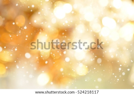 Abstract gold bokeh with snow, Christmas and new year theme background
