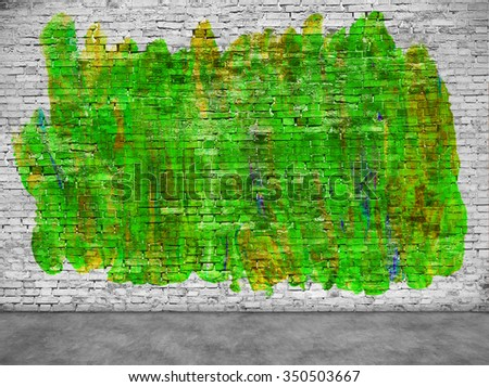 Abstract green graffiti over white brick wall