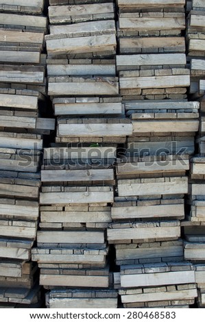 Abstract industrial background: wooden pallets in a factory yard