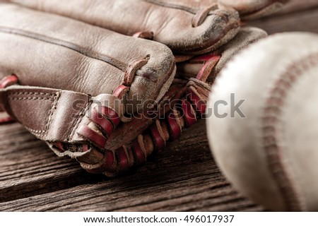 abstract old vintage baseball glove with baseball (Shallow depth of field)