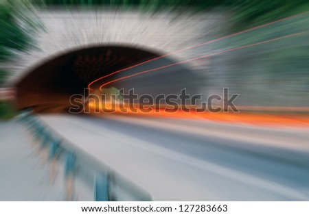Abstract speed. Car light trails in the tunnel. Very art image . Long exposure photo taken in a tunnel