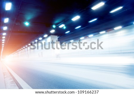 Abstract speed motion in urban highway road tunnel, blurred motion toward the central.