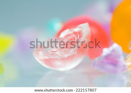Abstract textures and patterns of broken jelly balls with reflexions