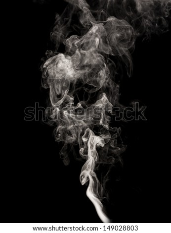 Abstract white smoke swirls over the black background