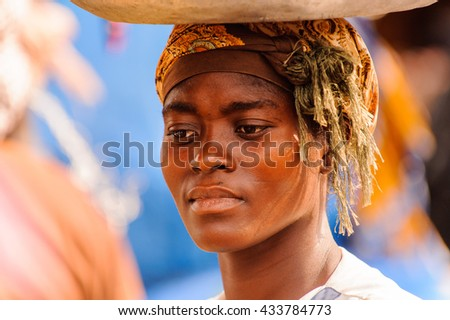 ACCRA, GHANA - MARCH 4, 2012: Unidentified Ghanaian woman portrait in the street in Ghana. People of Ghana suffer of poverty due to the unstable economic situation