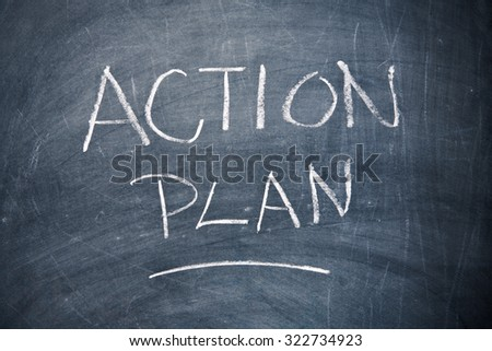 Action plan written with chalk on chalkboard