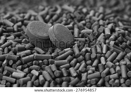Activated carbon granules and tablets close up