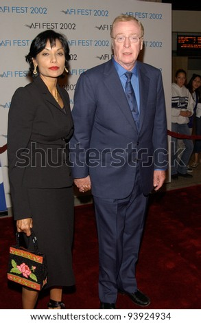 Actor MICHAEL CAINE & wife SHAKIRA at the Los Angeles premiere of his new movie The Quiet American, which was screened as part of the AFI Film Festival. 16NOV2002.   Paul Smith / Featureflash