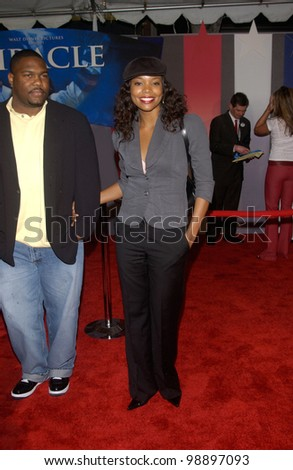 Actress GABRIELLE UNION & husband at the world premiere, in Hollywood, of Miracle. February 2, 2004