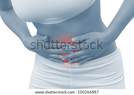Acute pain in a woman abdomen. Concept photo with blue skin with read spot indicating pain. Isolation on a white background