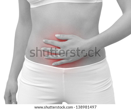 Acute pain in a woman belly. Female holding hand to spot of belly-ache. Concept photo with Color Enhanced blue skin with read spot indicating location of the pain. Isolation on a white background.
