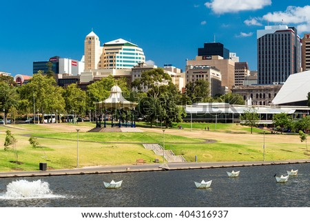 Adelaide, Australia - January 3, 2016: Adelaide city skyline viewed across the Elder Park on a bright day