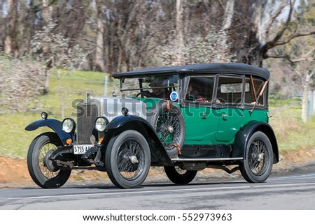 Adelaide, Australia - September 25, 2016: Vintage 1926 Vauxhall 14/40 Sedan driving on country roads near the town of Birdwood, South Australia.