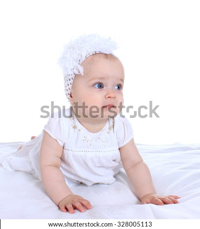 Adorable baby girl  in cute  clothes on blanket on a white background
