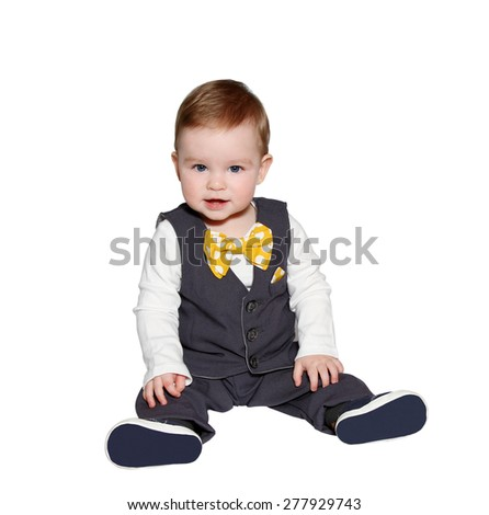 adorable baby wearing classic vest and colorful bowtie on white background