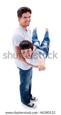 Adorable little boy carried by his father against a white background