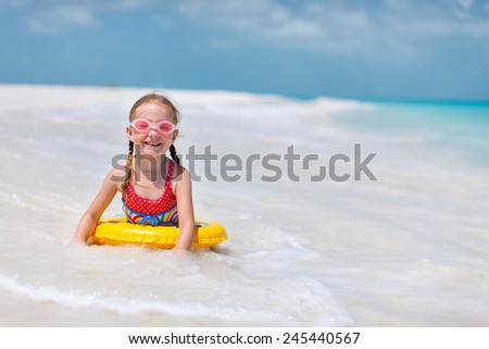 Adorable little girl enjoying holiday beach vacation