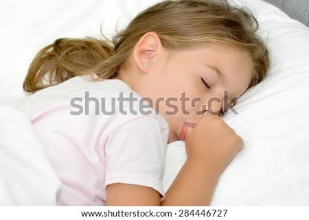 Little girl sleeping facial bad turn