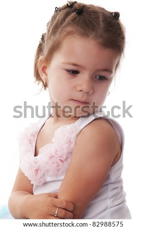 Adorable sweet little girl with princess dress looking sad