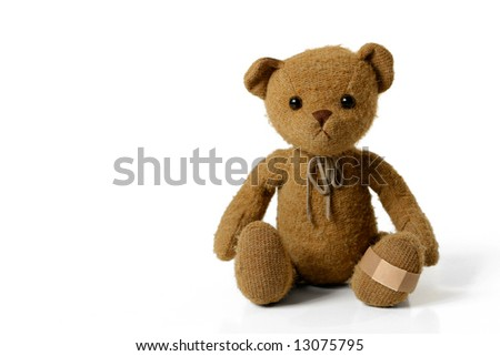 Adorable Teddy Bear with a Bandage on his Foot