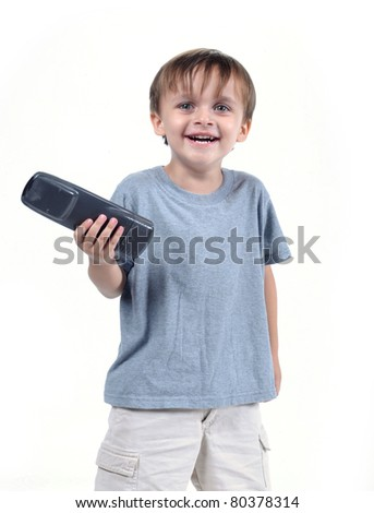 adorable 3 to 4 year old boy standing with tv remote isolated on white