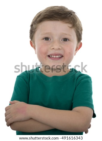 Adorable 5 year old American boy against white background.