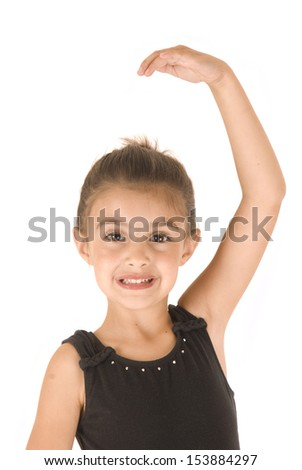 adorable young girl ballerina posing arm extended up