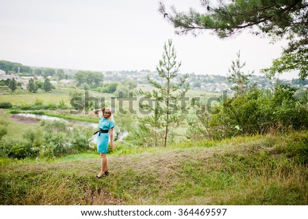Adult blonde woman posed at pine forest
