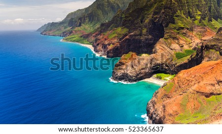 Aerial landscape view of Honopu Arch at Na Pali coastline, Kauai, Hawaii, USA