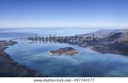 Aerial photo of Lituya Bay off the coast of Southeast Alaska on a sunny day with blue sky.