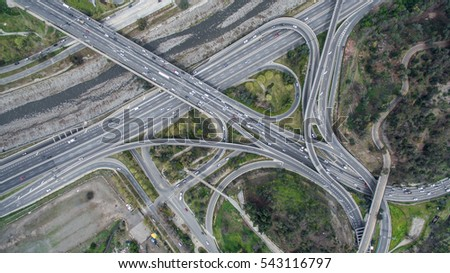 aerial view of a higway intersection junction and a bridge over a river