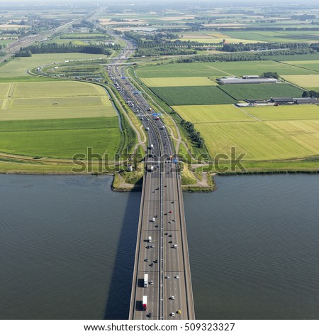 Aerial view of bridge MOERDIJK BRUGGEN over the river HOLLANDSCH DIEP in Holland. The bridge connects the provinces of Zuid-Holland and Noord-Brabant.