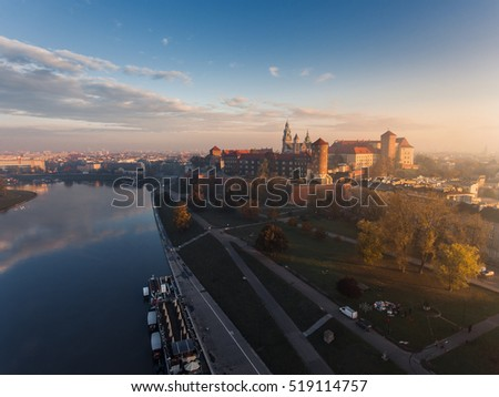 Aerial view of castle at sunrise in the mystic fog with river.  Krakow, Poland