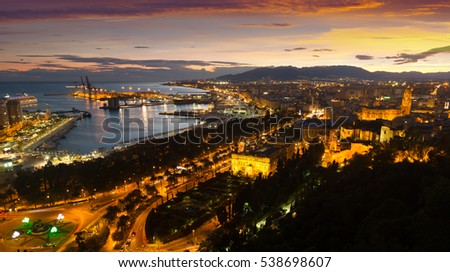 Aerial view of Malaga and Mediterranean in  evening .  Spain