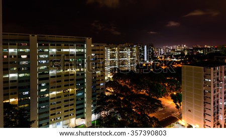 Aerial view of new estate, HDB housing complex with neighborhood faculties car park and green garden at the center at Eunos area of Singapore. Night view. Panoramic style
