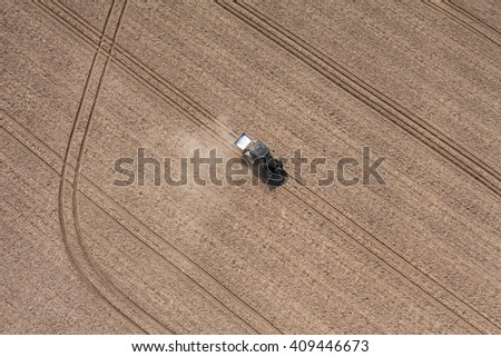 aerial view of the tractor working on the harvest field  in Poland