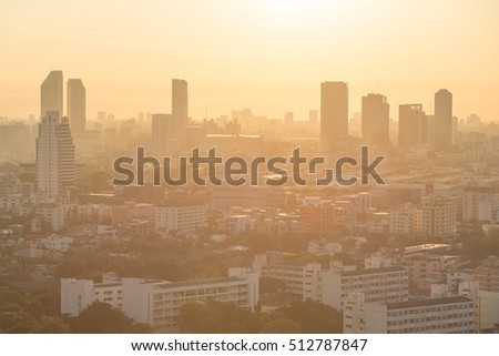 Aerial view of urban city skyline at sunrise, beautiful building layers in downtown of Bangkok, cityscape background or backdrop in vintage warm tone and modern retro style