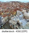 Aerial view of Venice. Cathedral, sea and roofs of houses  and palaces from San Marco tower - stock photo