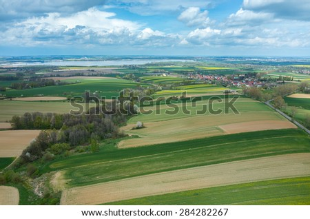 Aerial view on a small village surrounded by green fields