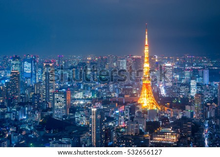 Aerial view over Tokyo tower and Tokyo cityscape view from Roppongi Hills at night in Japan.