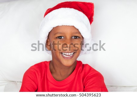 African American Boy Wearing Christmas Santa Hat -on white background