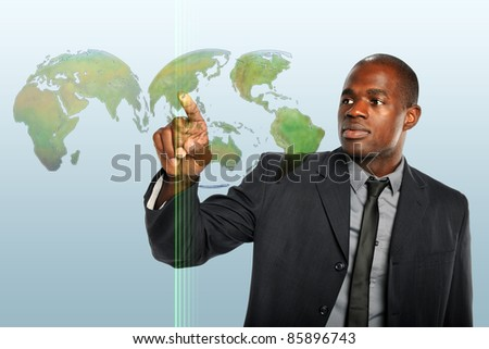 African American businessman touching world map hologram