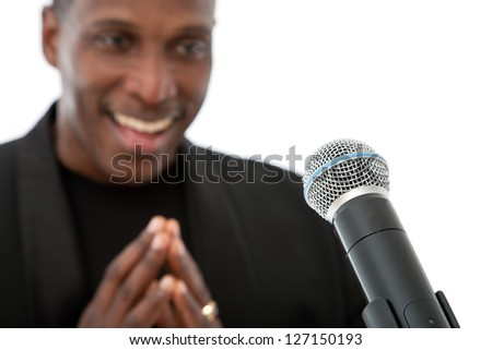 African American singer standing on a white background