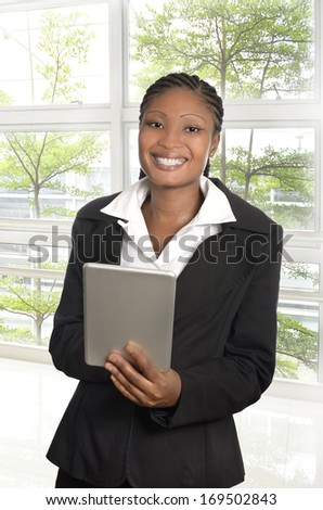 African business woman with Tablet PC, Studio Shot