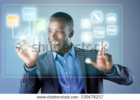 African businessman smiling while using finance trading digital hologram display for work, analysing business information and data